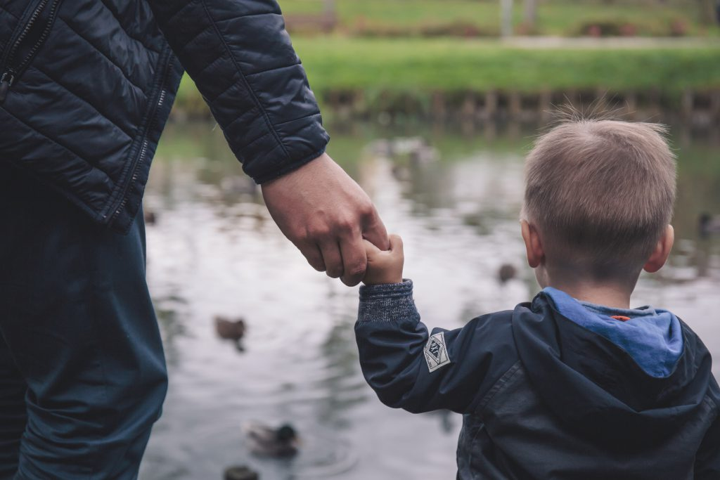 Dad and son holding hands - free stock photo