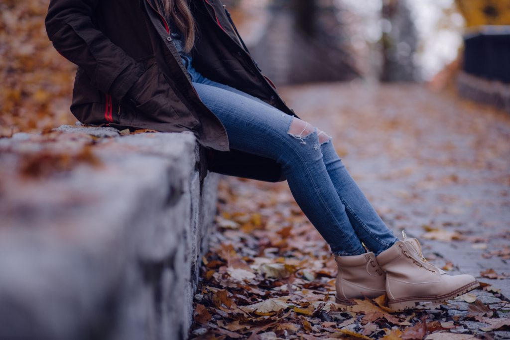 Girl sitting on the park wall - free stock photo