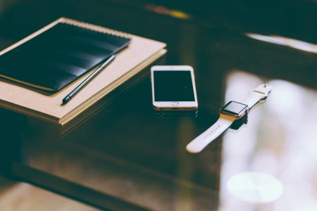 iPhone, iWatch and notebook - free stock photo