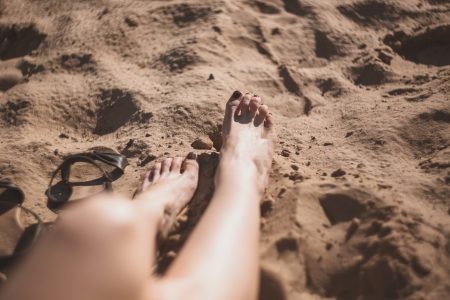 Legs in the sand - free stock photo