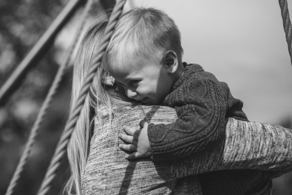 Mom and son hugging - free stock photo