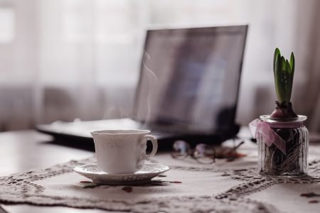 Cup of coffee, flower and laptop - free stock photo