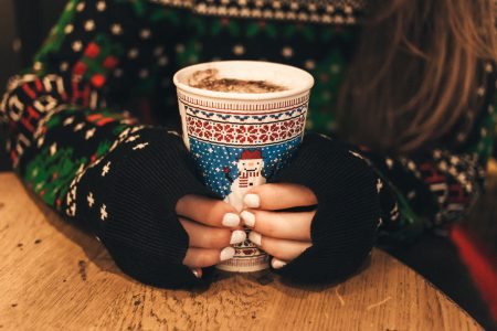 Girl holding christmas coffee cup