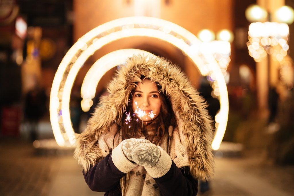 Girl holding a sparkler - free stock photo