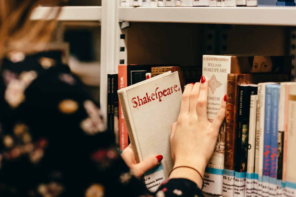 Girl in a library - free stock photo