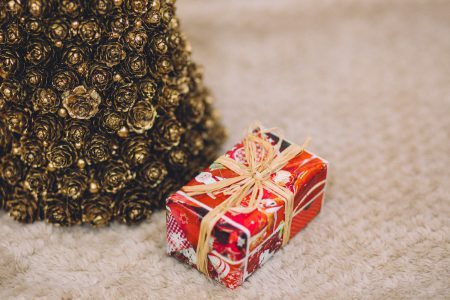 Gold Christmas tree and present - free stock photo