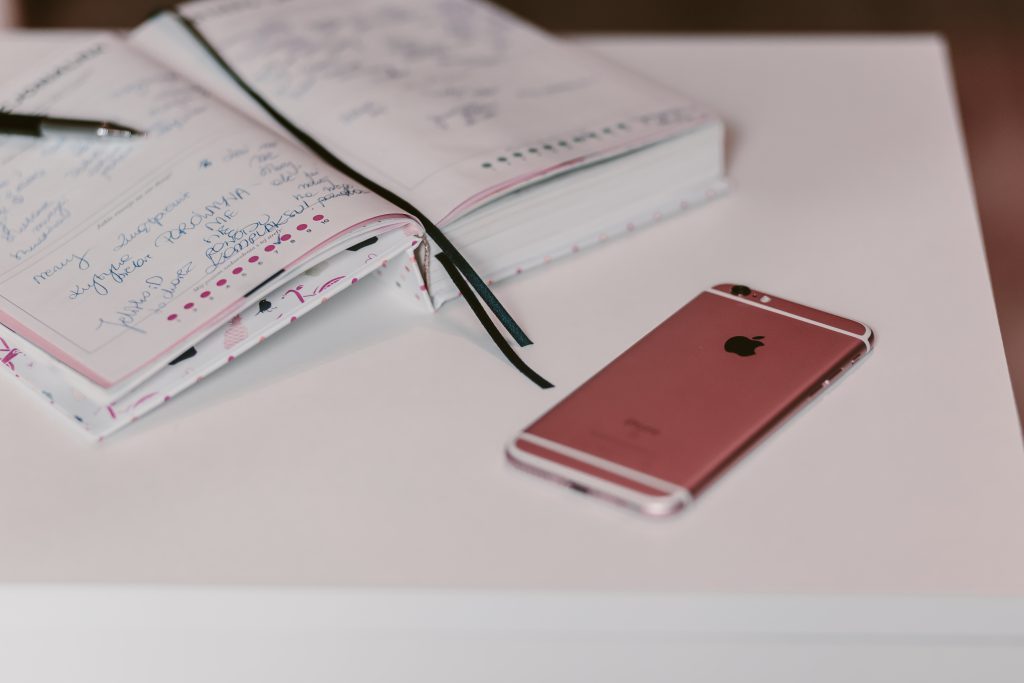 iPhone and planner 3 - free stock photo