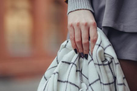 Scarf in female hand - free stock photo