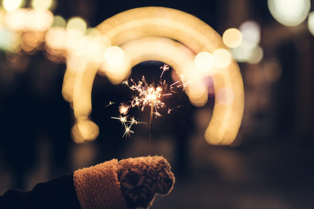 Sparkler and a wollen glove - free stock photo