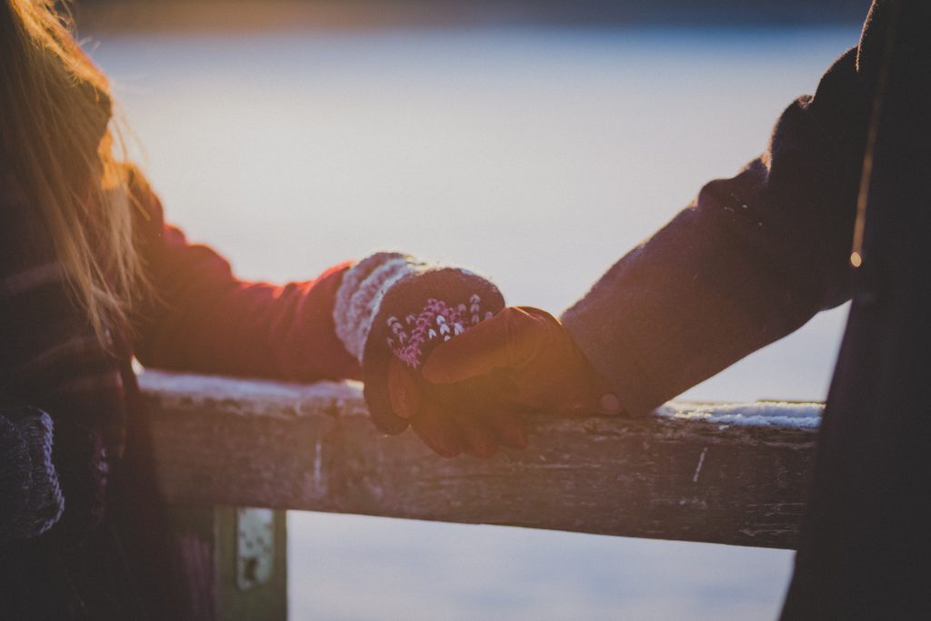 A couple holding hands in winter - free stock photo