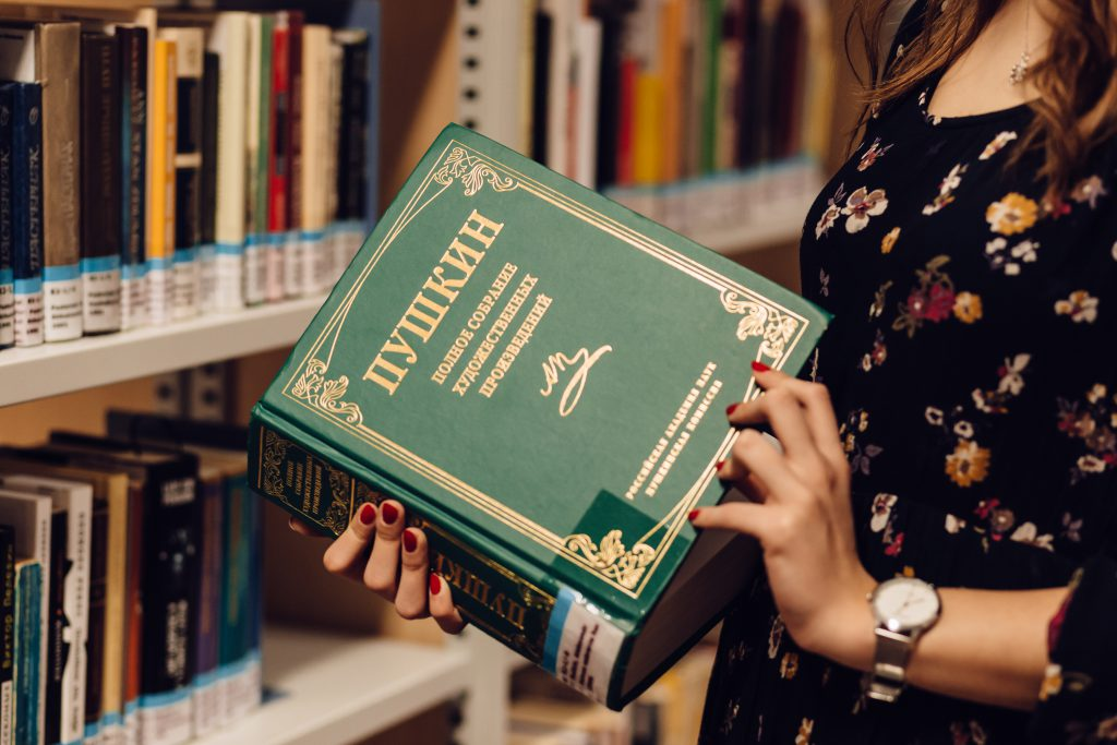 Girl in a library 2 - free stock photo