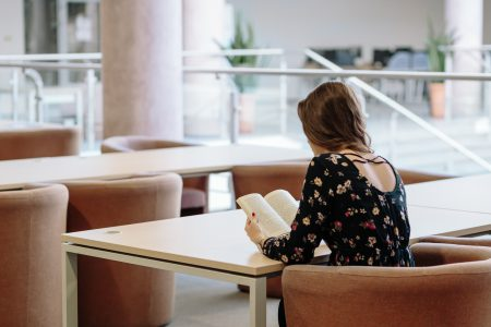 Girl in a reading room - free stock photo