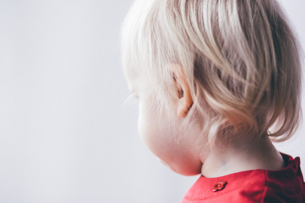 Little girl looking out the window - free stock photo