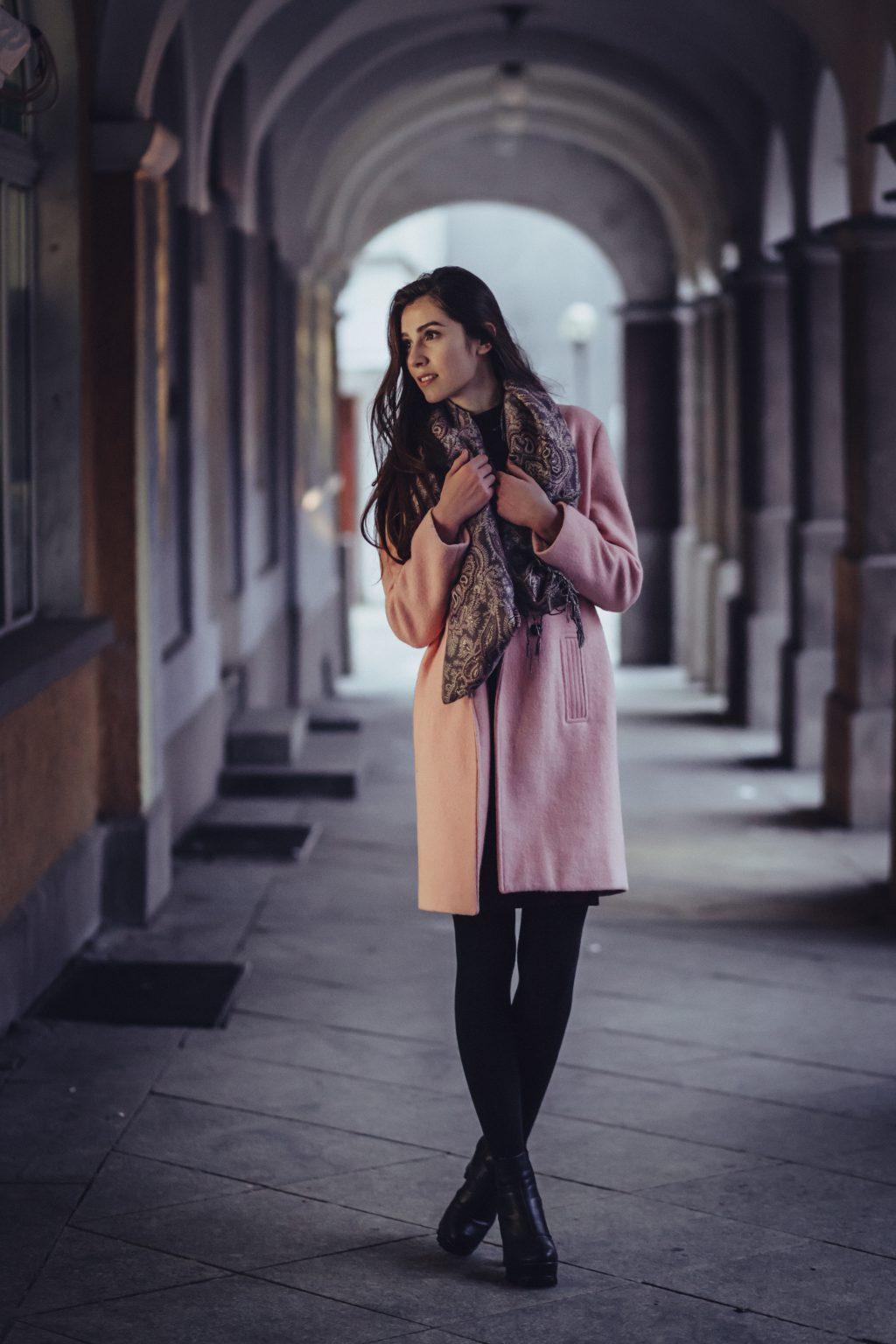 A woman posing under arcades - free stock photo
