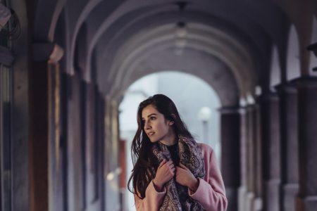 woman posing under arcades