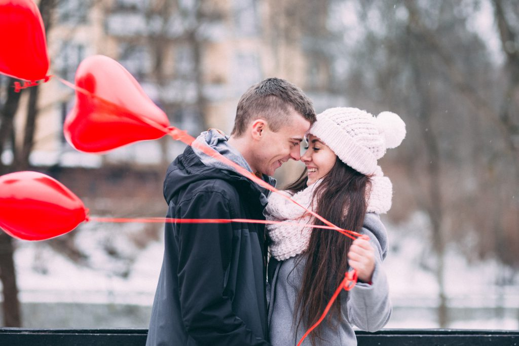 A couple with heart shape baloons 3 - free stock photo