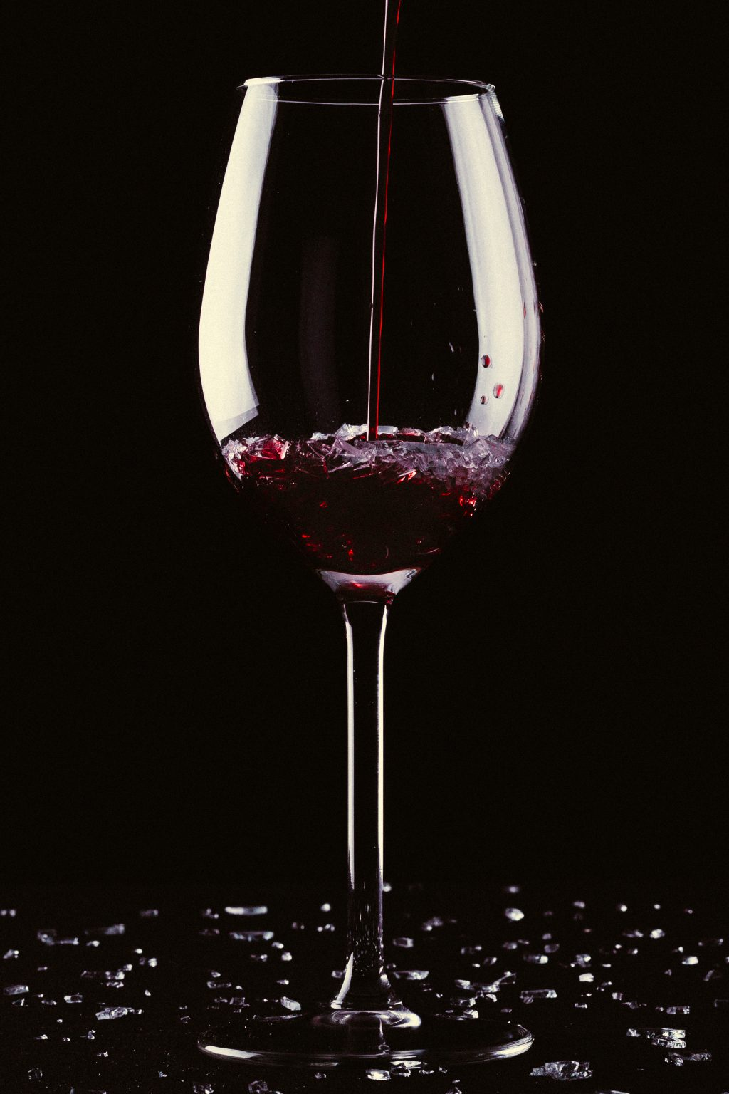 Glass of wine with broken glass - free stock photo