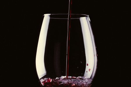 Glass of wine with broken glass