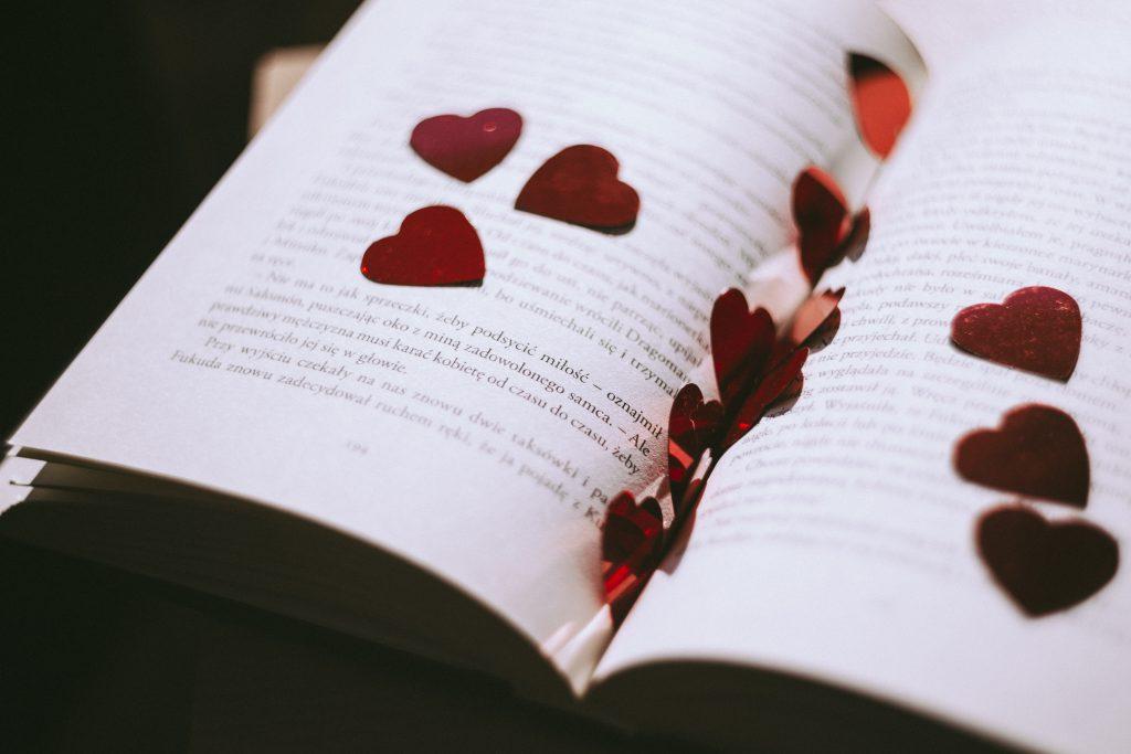 Heart confetti in an open book - free stock photo
