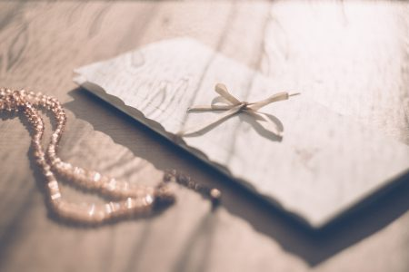 Invitation card with a ribbon - free stock photo