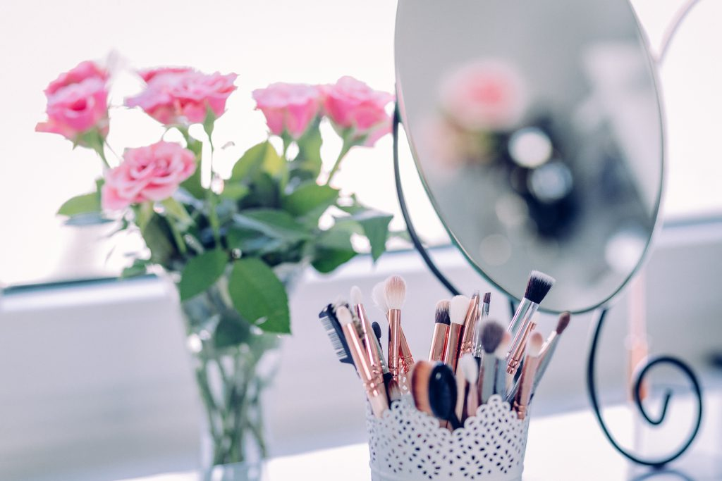 Makeup brushes and roses - free stock photo