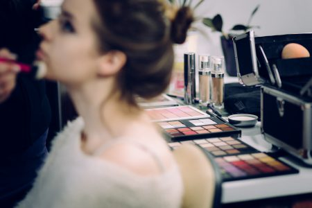 A model and a makeup artist at work - free stock photo