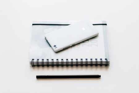 A planner and a phone - free stock photo