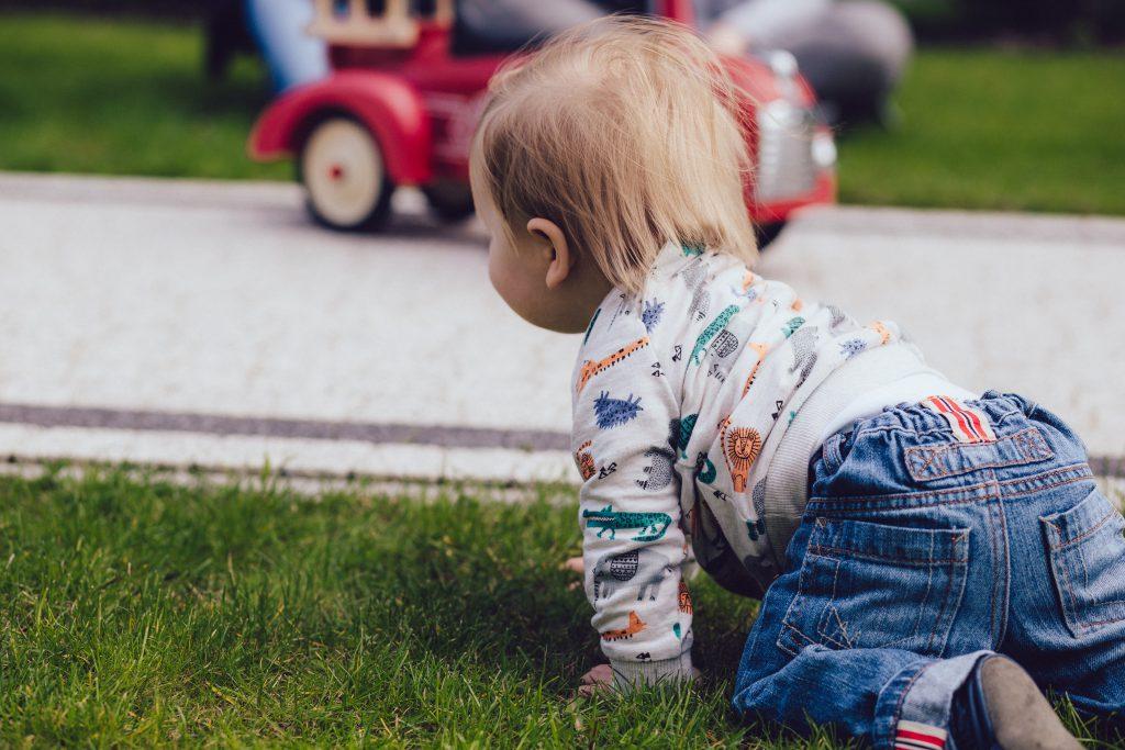 Baby boy crawling outdoors - free stock photo