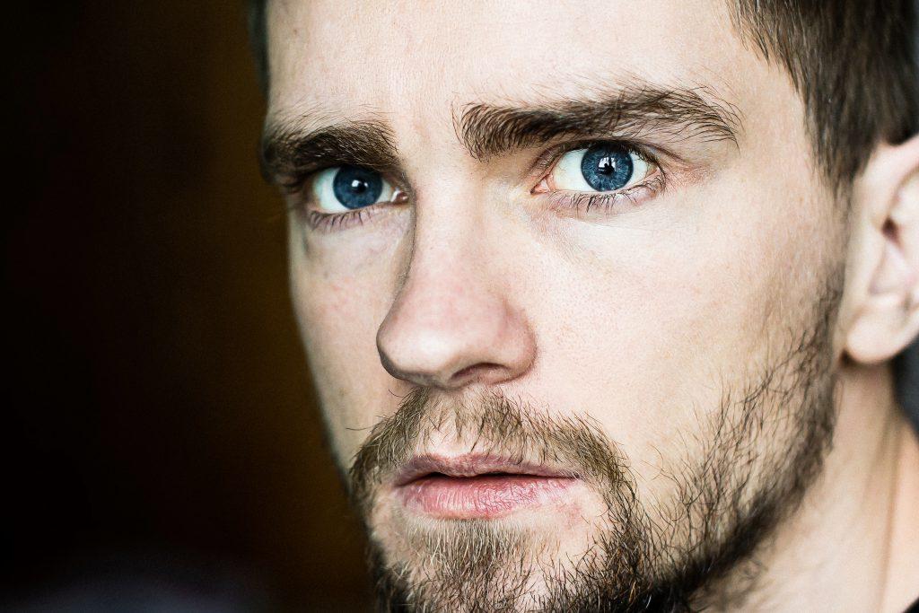 A dramatic male portrait - free stock photo