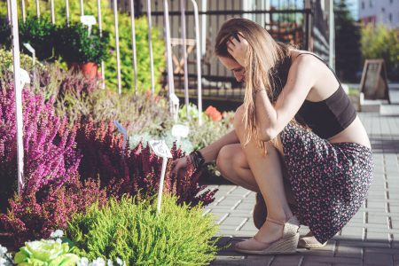 A girl looking at flowers - free stock photo