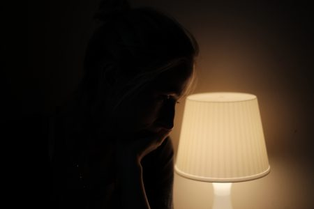 Woman in lamplight