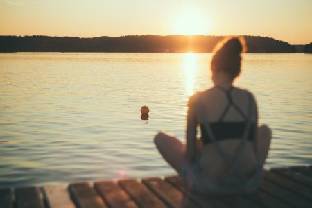 A girl sitting on a pier blurred - free stock photo