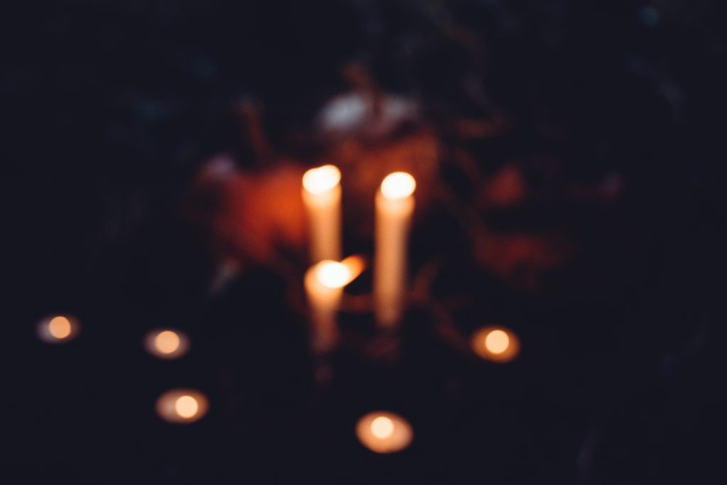 Halloween candles and pumpkins blur - free stock photo
