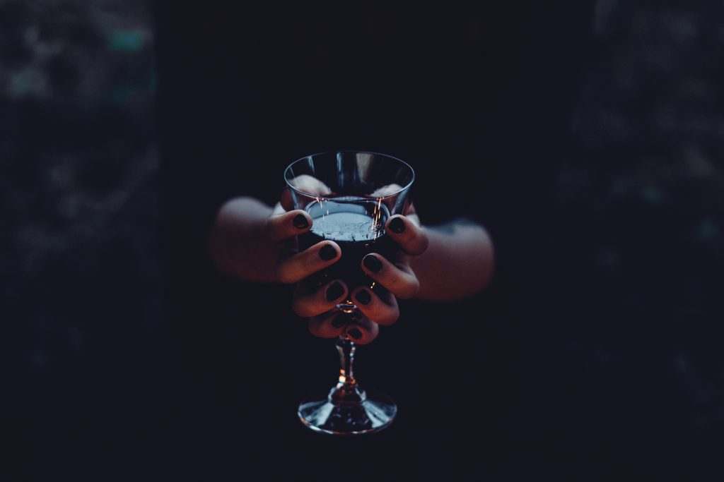 A witch holding a glass of wine 2 - free stock photo