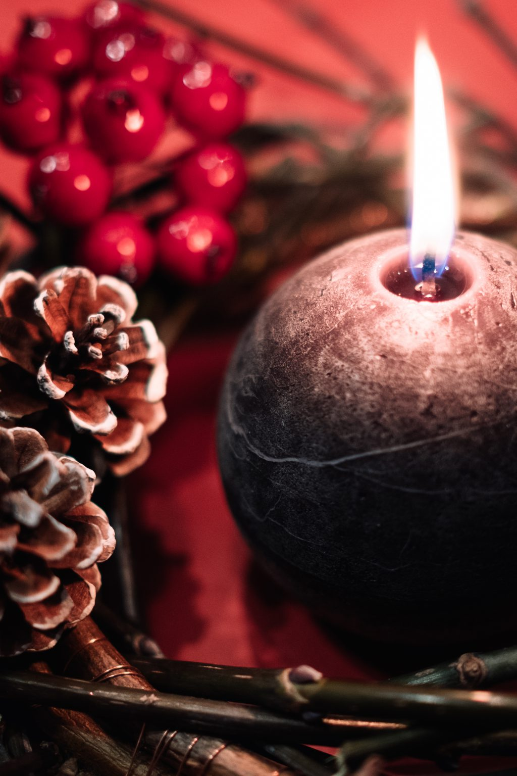 Christmas wreath and a round candle closeup - free stock photo