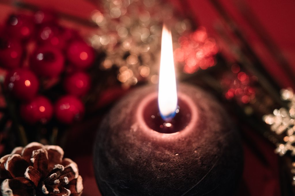 Christmas wreath and a round candle closeup 2 - free stock photo