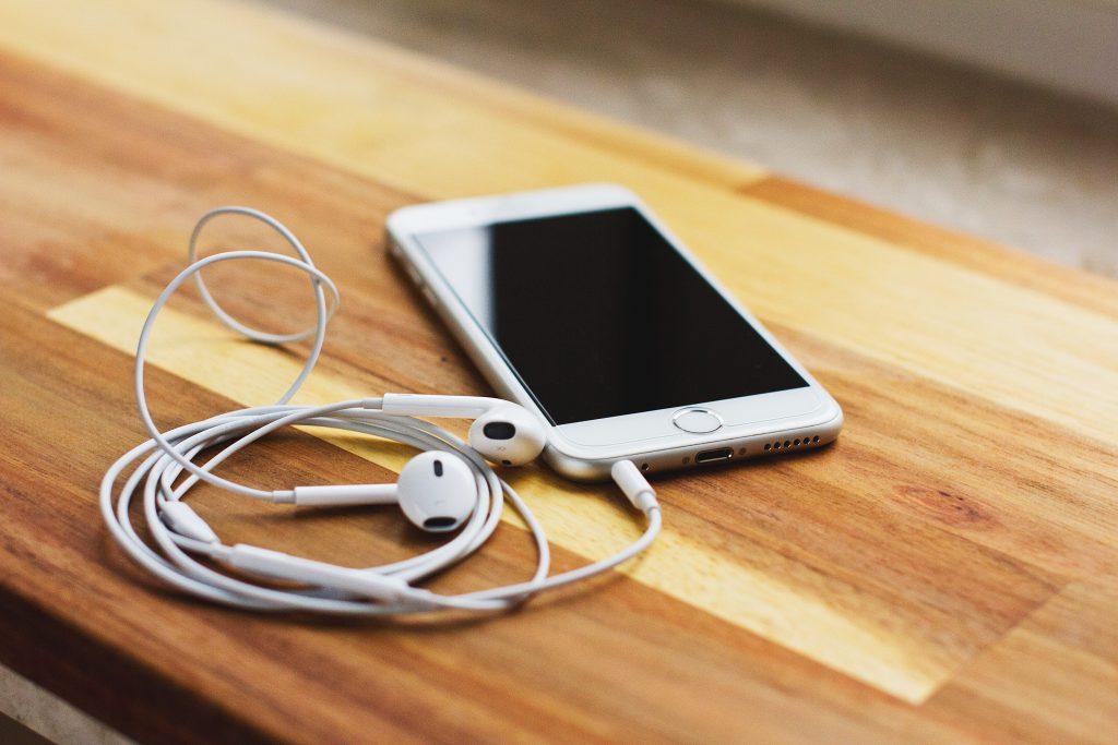 iPhone 6s with headphones - free stock photo