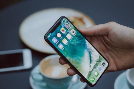 Male holding an iPhone X