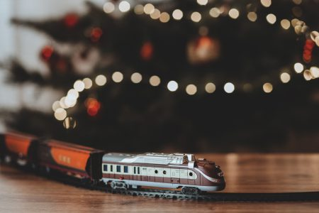 Toy train going around the Christmas tree - free stock photo