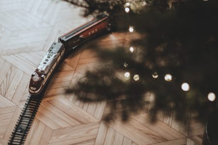 Toy train going around the Christmas tree 2 - free stock photo