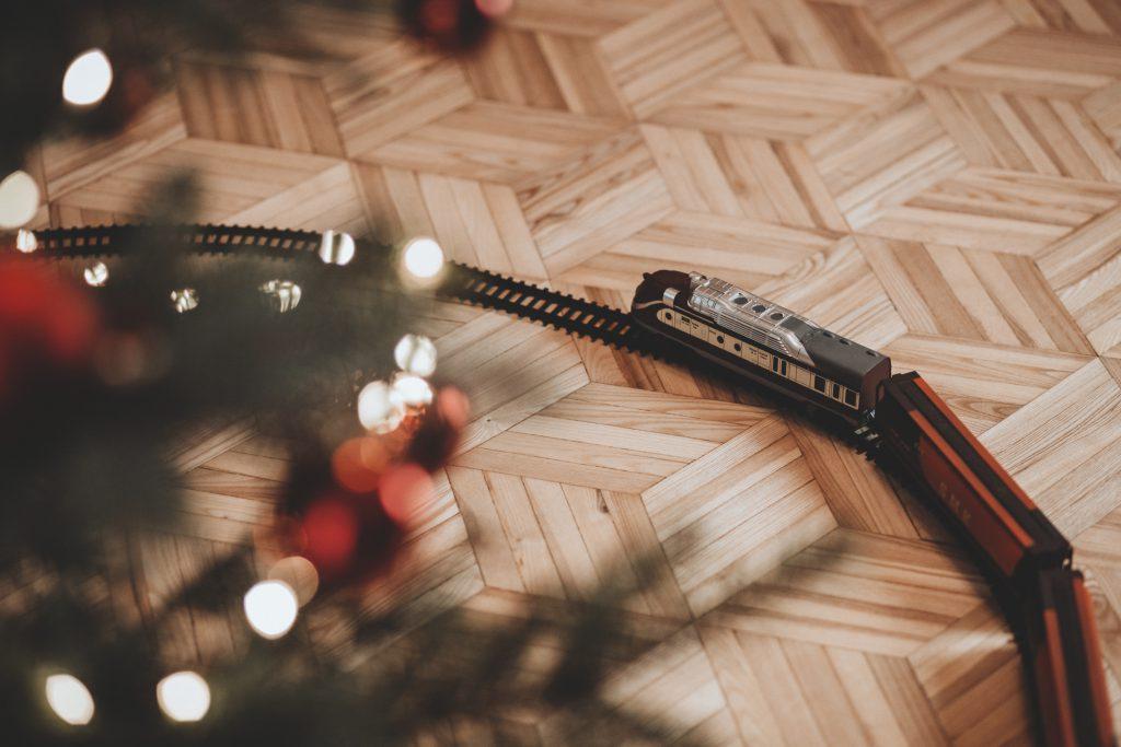 Toy train going around the Christmas tree 3 - free stock photo