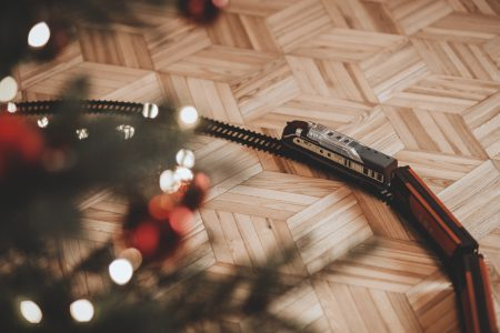 Toy train going around the Christmas tree 3 - free stock photo