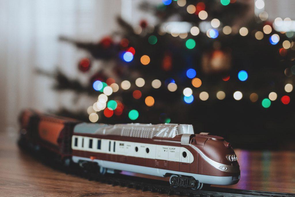 Toy train going around the Christmas tree 4 - free stock photo