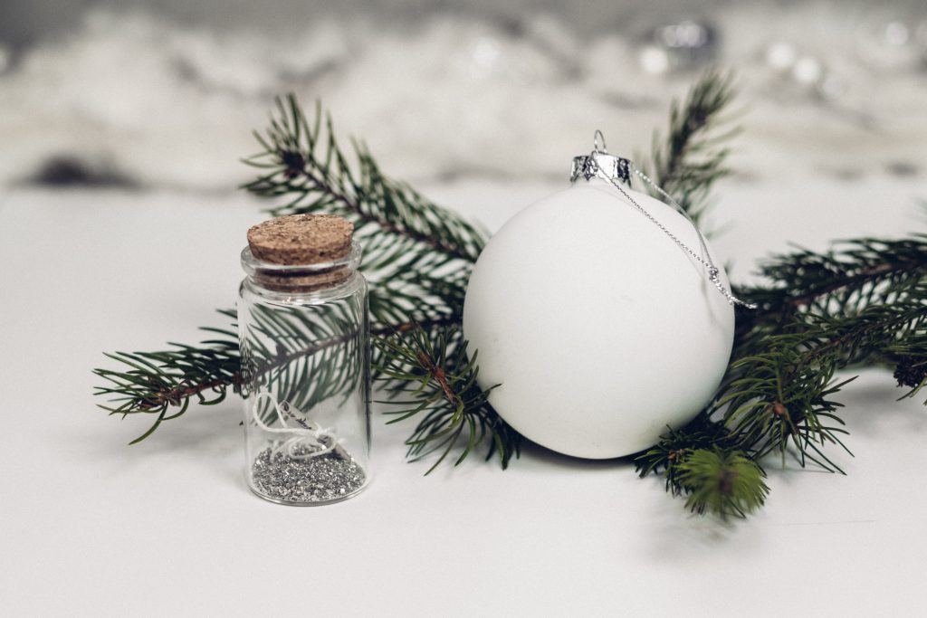 White and silver bauble with a spruce twig - free stock photo