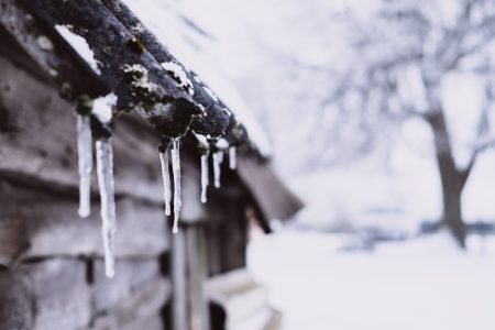 Icicles on a wooden shed - free stock photo