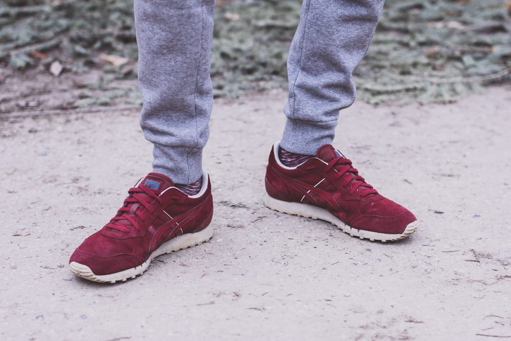 Male feet in red snickers - free stock photo