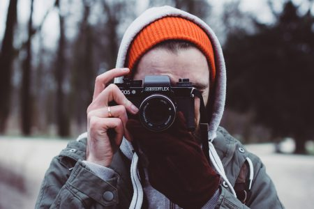 Man shooting with an analog camera - free stock photo