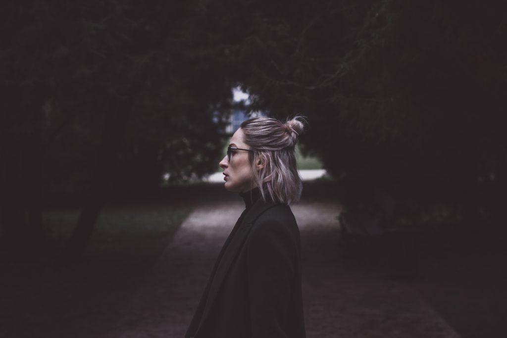 Moody outdoor female profile portrait - free stock photo