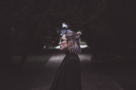 Moody outdoor female profile portrait - free stock photo