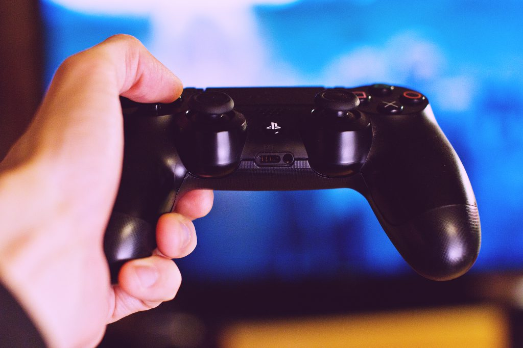 PlayStation pad in a male hand